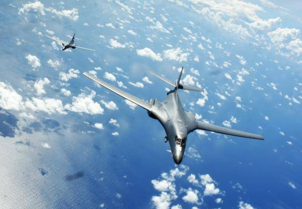 Two US Air Force B-1B bombers fly over the South China Sea while operating with the destroyer USS Sterett. Photo: USAF / Richard Ebensberger