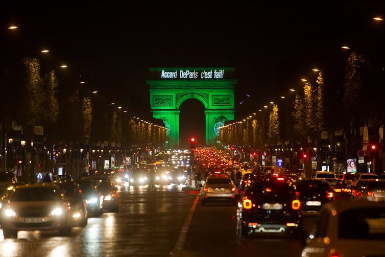 The Arc de Triomphe Is illuminated in green to celebrate the Paris Agreement's entry into force. Photo: US State Department