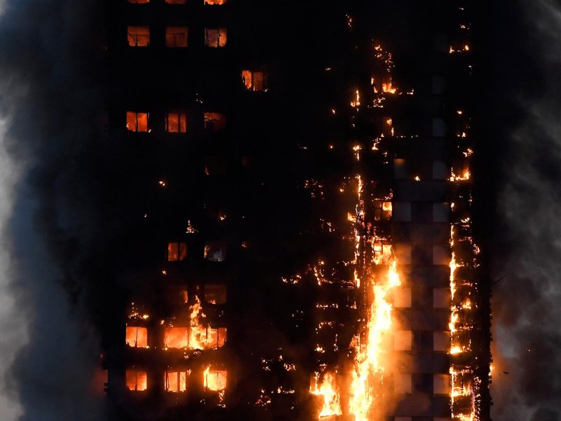 Flames and smoke billow as firefighters deal with a serious fire in a tower block in West London, Britain June 14, 2017. Photo: Reuters