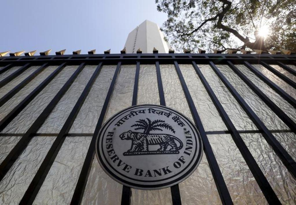 The Reserve Bank of India seal appears on a gate outside the RBI headquarters in Mumbai. Photo: Reuters