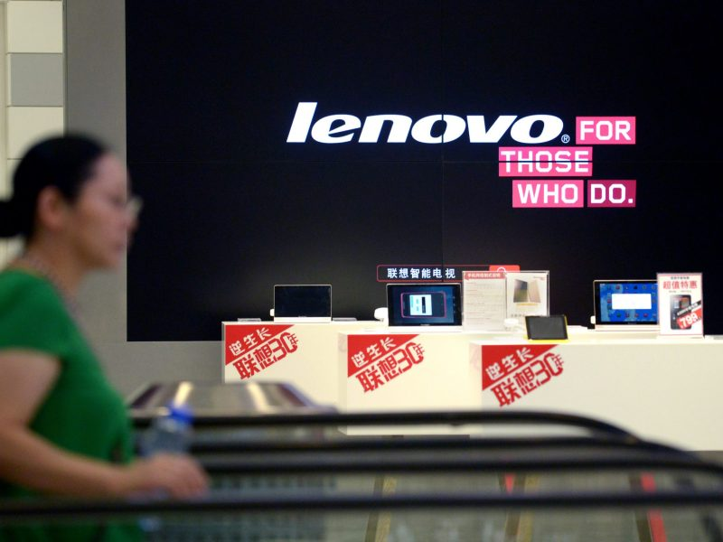 A woman walks past a Lenovo store in Beijing. Photo: AFP / Wang Zhao