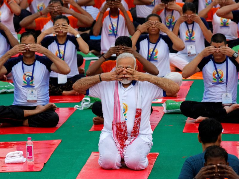 Indian Prime Minister Narendra Modi performs yoga on International Yoga Day in Lucknow, India June 21, 2017. REUTERS/Pawan Kumar
