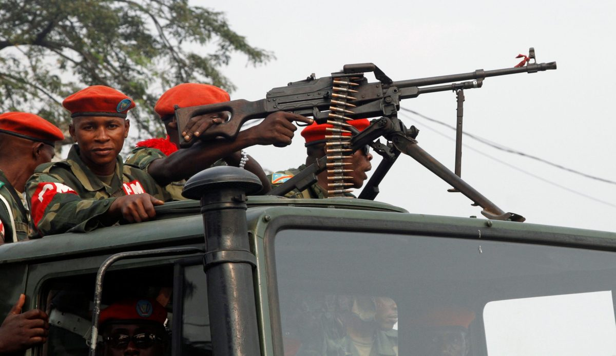 Military police officers ride on a truck as they patrol the streets of Kinshasa, Democratic Republic of Congo. Photo: Reuters/Kenny Katombe