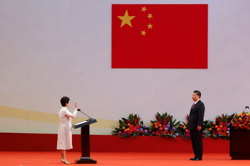 Hong Kong Chief Executive Carrie Lam takes her oath in front of Chinese President Xi Jinping on the 20th anniversary of the city's handover from British to Chinese rule, in Hong Kong, China, July 1, 2017.   REUTERS/Bobby Yip