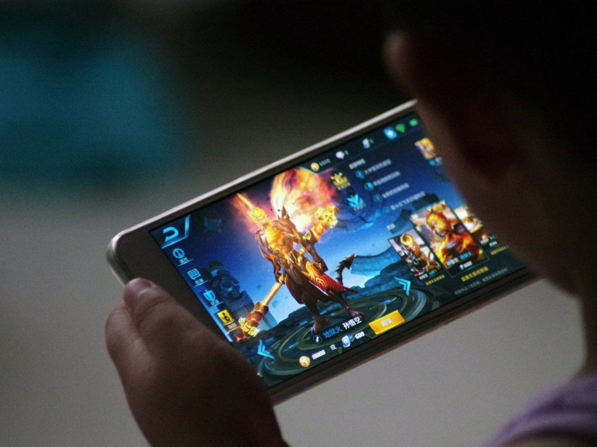 A child plays the game Honor of Kings by Tencent. Photo: Reuters