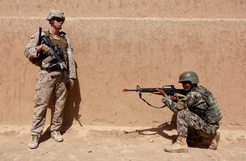 A US marine stands next to an Afghan National Army soldier during a training exercise in Helmand province on July 5, 2017. Photo: Reuters/Omar Sobhani