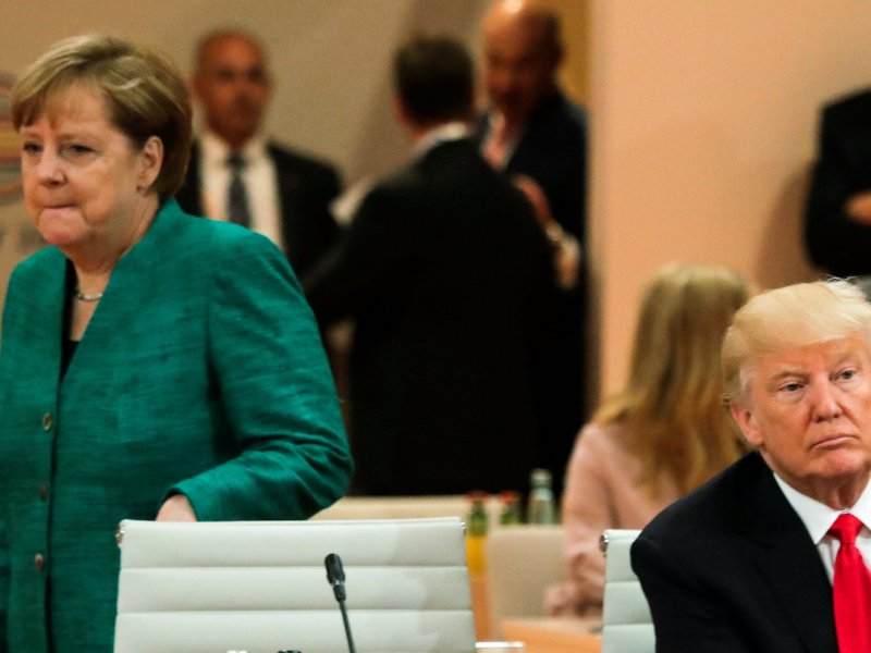 US President Donald Trump and German Chancellor Angela Merkel at the G20 summit in Hamburg on July 8, 2017.       Photo: Reuters/Markus Schreiber, Pool