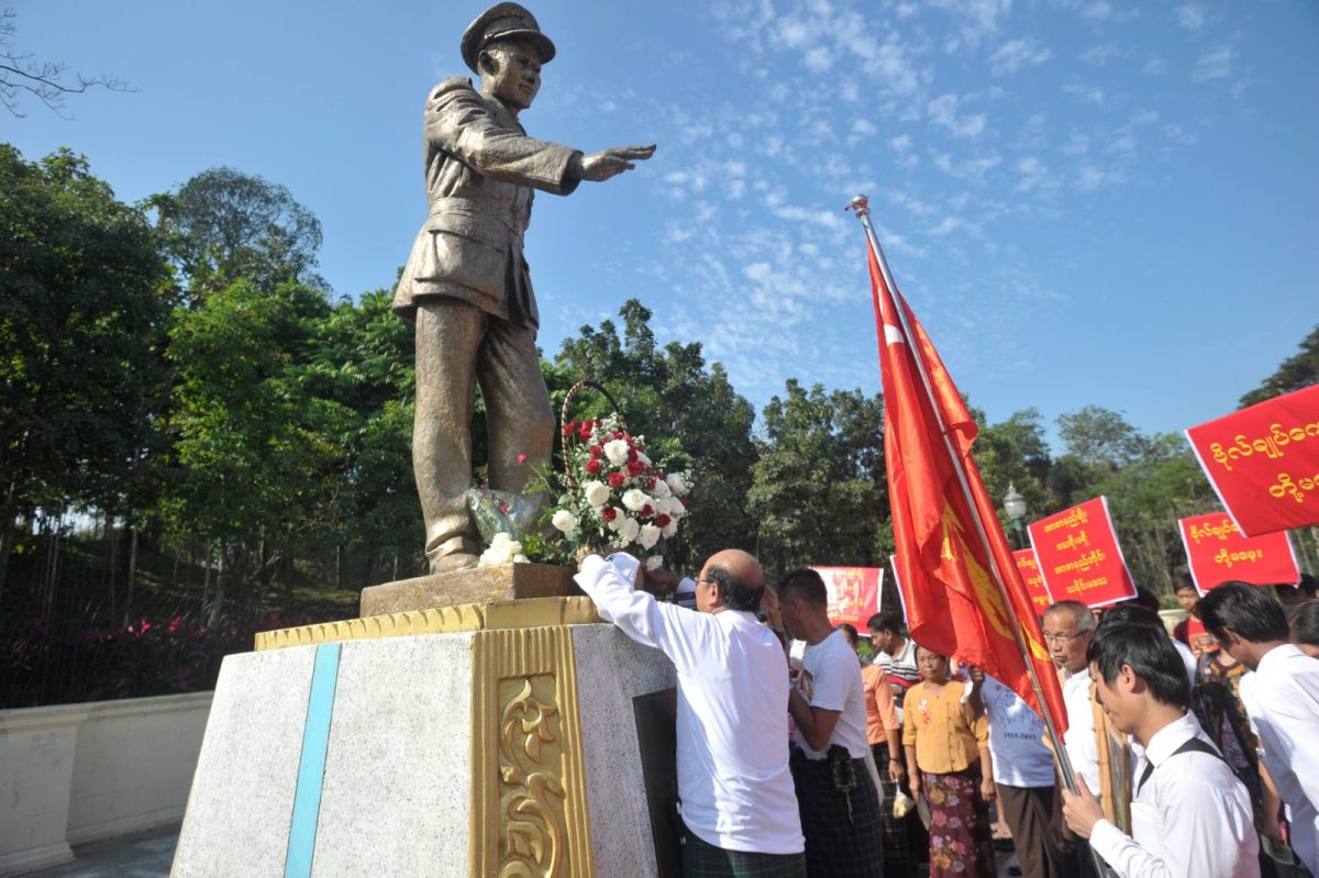 Members of the NLD party lay a wreath in front of the late General Aung San statue to mark the 100th birthday of independence hero Aung San, in Yangon on February 13, 2015.  A similar statue was damaged recently in the country's north where a bitter war is being fought against the Kachin. Photo: AFP / Soe Than Win