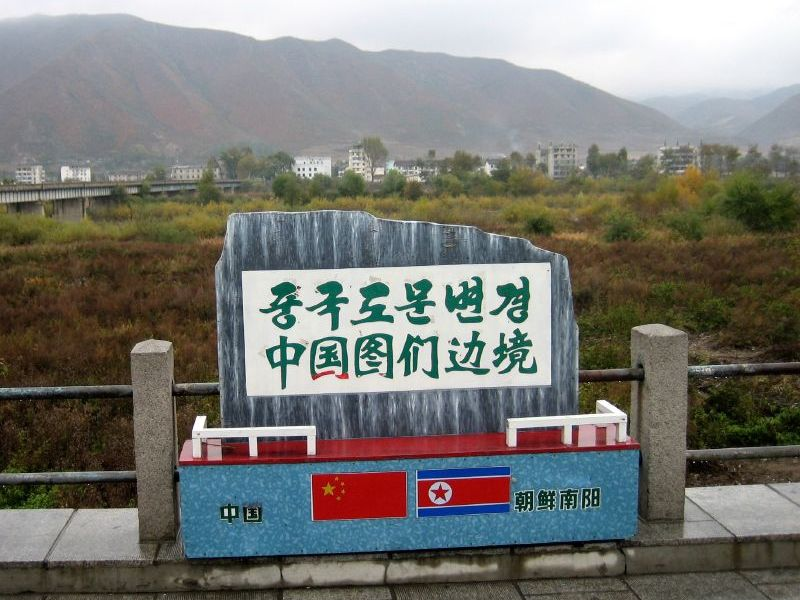 A sign marking North Korea's border with China. Photo: Wikipedia