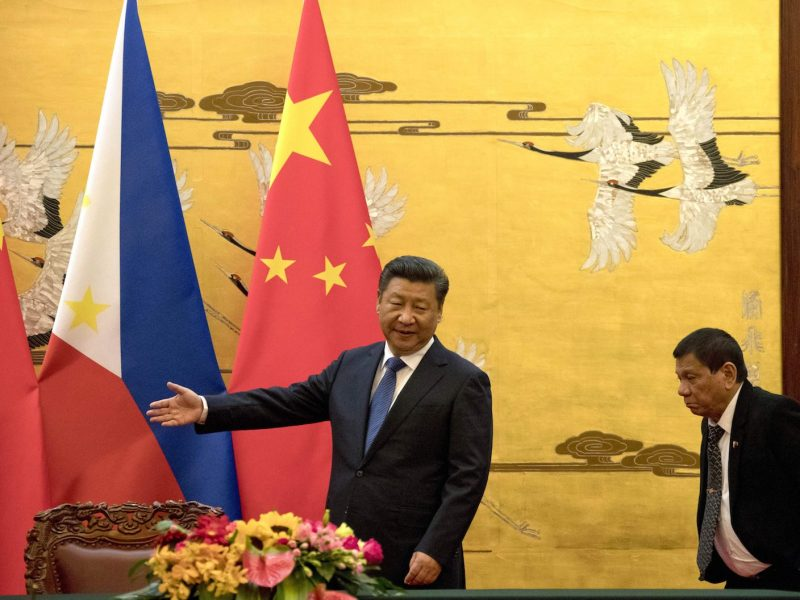 Philippine President Rodrigo Duterte, right, is shown the way by his Chinese counterpart Xi Jinping before a signing ceremony in Beijing in October 2016. Photo: AFP.