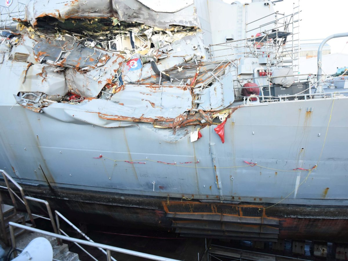 The guided-missile destroyer USS Fitzgerald sits in a dry dock in Yokosuka, Japan, for repairs after a deadly collision at sea. Photo: US Navy / Leonard Adams