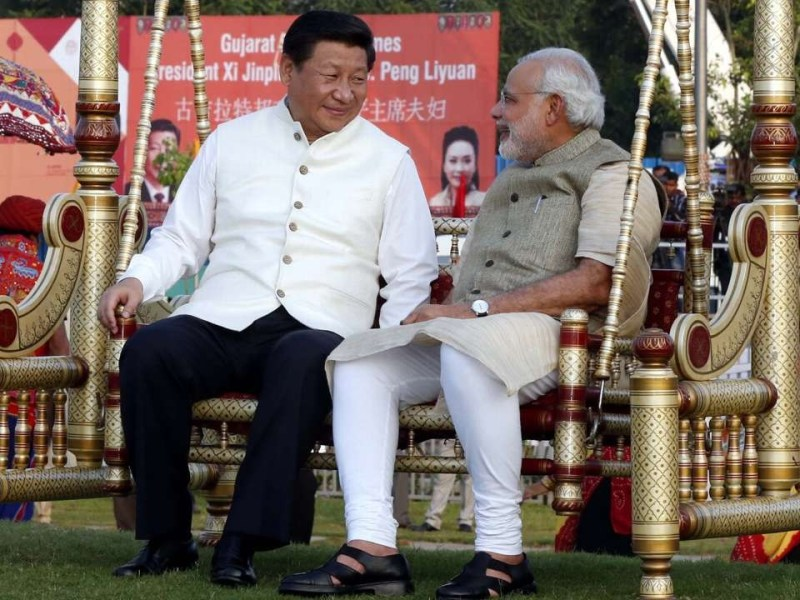 Chinese President Xi Jinping  (L) with Indian Prime Minister Narendra Modi during his India visit in 2014. --  Photo/Xinhua/Files