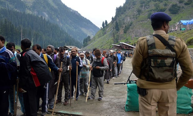 A soldier stands guard as Hindu pilgrims take part in the annual Amarnath Yatra. Photo: Muneeb/ Pacific/ Barcroft