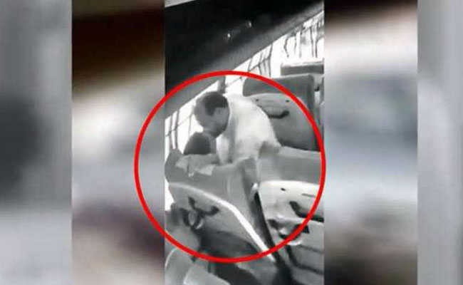 Ravindra Bawanthade was filmed kissing a woman on a moving public bus on June 27. Photo: NDTV