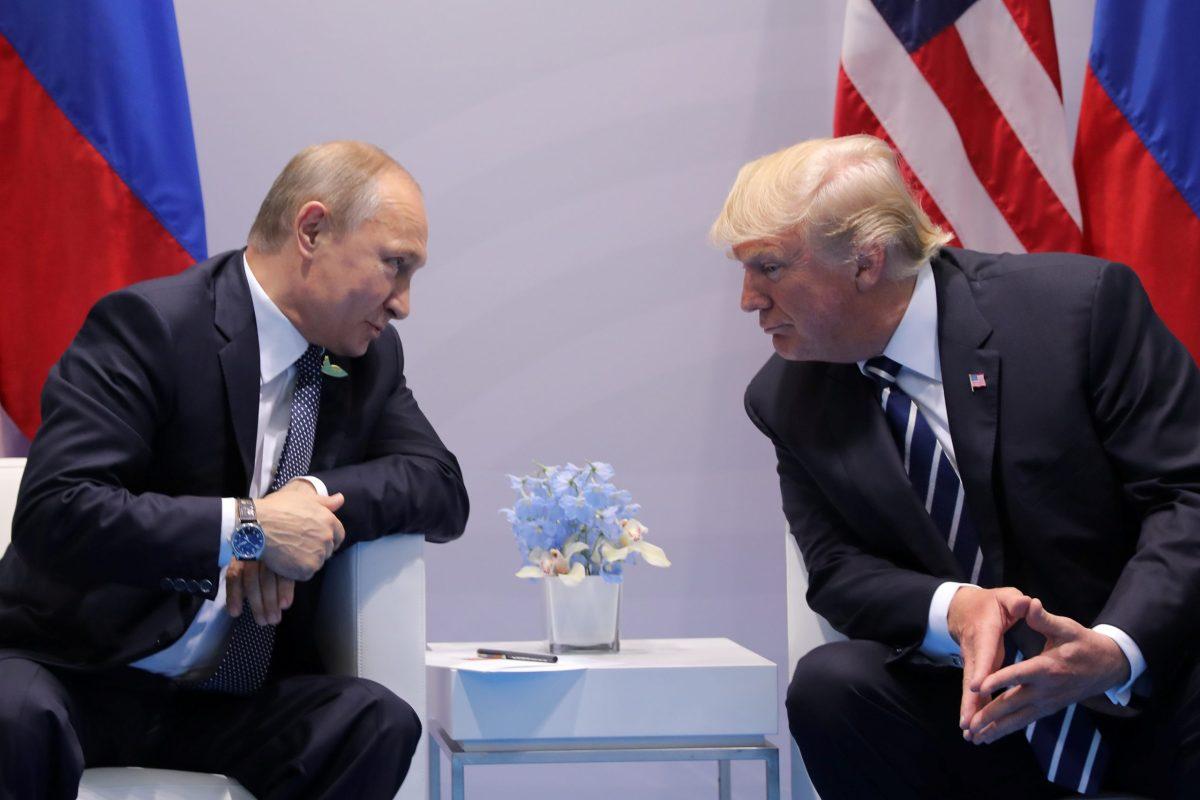Russian President Vladimir Putin talks to US President Donald Trump at the G20 summit in Hamburg. Photo: Reuters/Carlos Barria