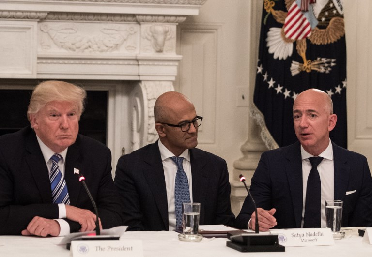 Trump and Microsoft CEO Satya Nadella listen to Amazon CEO Jeff Bezos during an American Technology Council roundtable at the White House. Photo: AFP/Nicholas Kamm