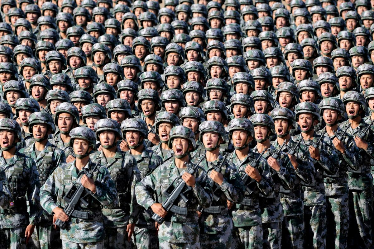 Soldiers of China's People's Liberation Army (PLA) get ready for the military parade to commemorate the 90th anniversary of the foundation of the army at Zhurihe military training base in Inner Mongolia Autonomous Region, China, July 30, 2017. Photo: China Daily via REUTERS