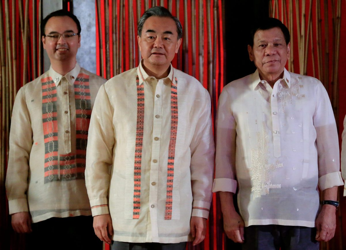 Philippine President Rodrigo Duterte with Chinese Foreign Minister Wang Yi and Secretary of Foreign Affairs Alan Peter Cayetano during a courtesy call for the 50th ASEAN Foreign Ministers' Meeting in Manila on August 8. Photo: Reuters/Romeo Ranoco