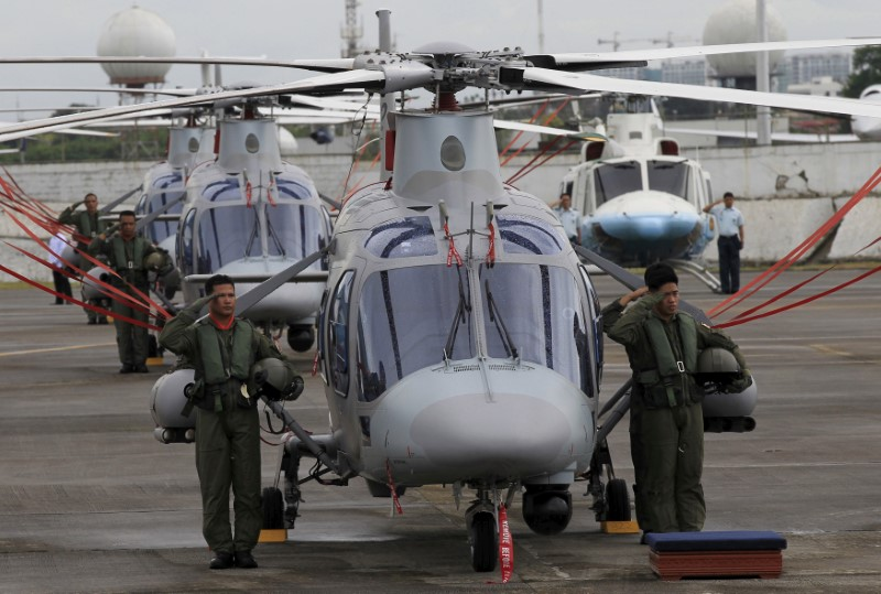 Philippine Air Force pilots stand next to  AgustaWestland AW109E helicopters in Manila.k Photo: Reuters/Romeo Ranoco