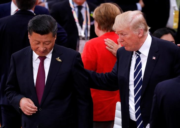 President Trump talks to Xi Jinping during the G20 leaders summit in Hamburg, Germany July 7, 2017.  Photo: Reuters/Philippe Wojazer