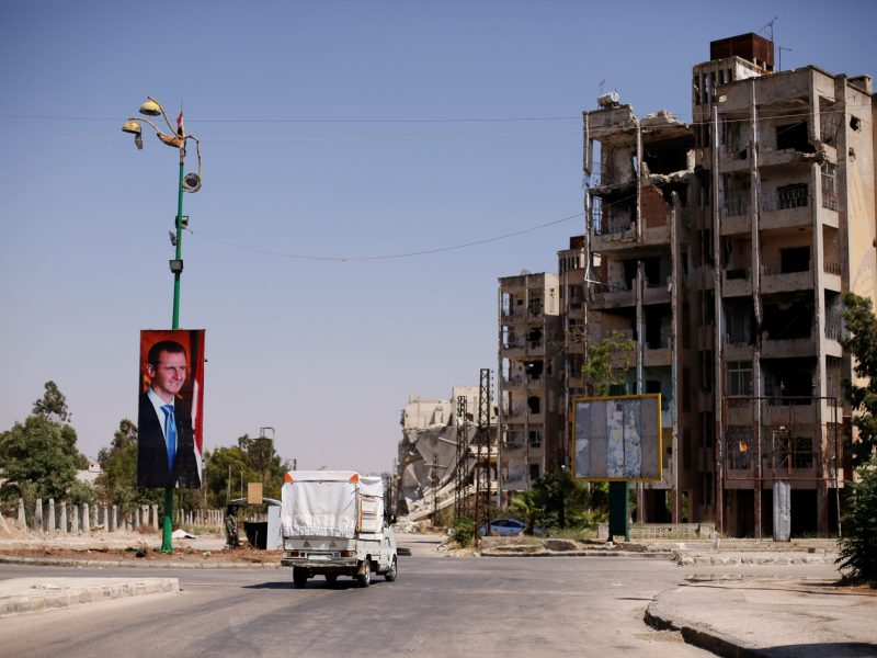 A picture of Syria's President Bashar al-Assad is seen in the Waer district  of Homs, Syria, on July 26, 2017. Photo: Reuters / Omar Sanadiki