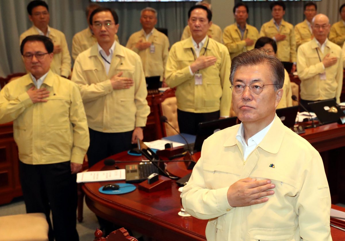 South Korean President Moon Jae-in salutes the national flag during a cabinet meeting at the Presidential Blue House in Seoul, South Korea, August 21, 2017.   Kim Ju-hyoung/Yonhap via REUTERS