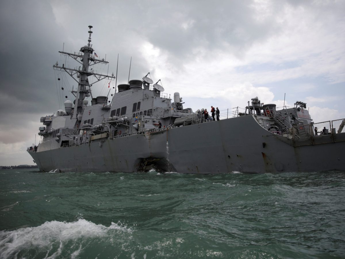 The US Navy guided-missile destroyer USS John S McCain is seen after a collision, in Singapore waters August 21, 2017. Photo: Reuters / Ahmad Masood
