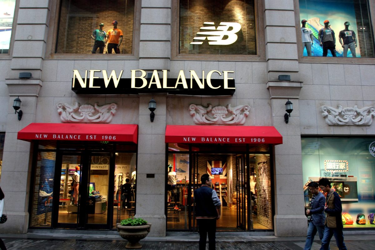 People walk past a New Balance store in Wuhan, Hubei province, China. Photo: Reuters