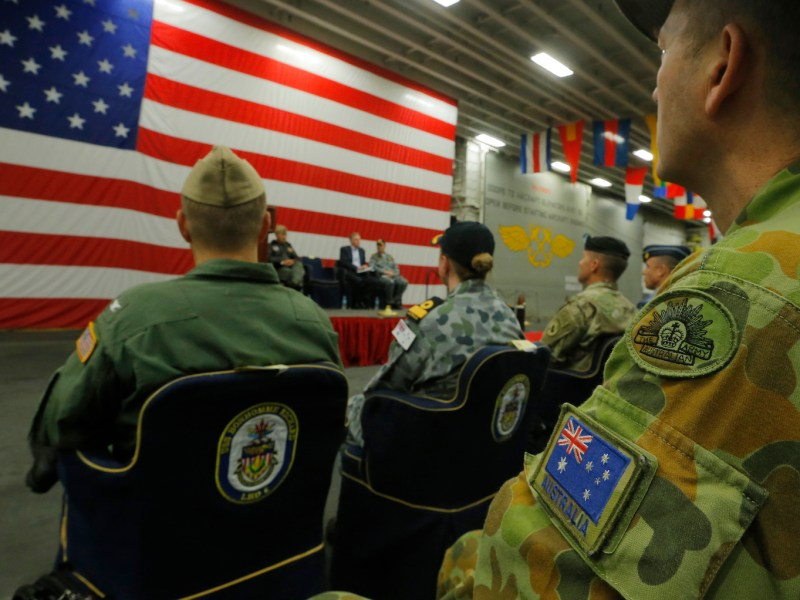 An Australian Army soldier sits in the audience at a ceremony marking the start of Talisman Saber 2017, a biennial joint military exercise between the United States and Australia aboard the USS Bonhomme Richard amphibious assault ship off the coast of Sydney on June 29, 2017. Photo: AFP/Jason Reed