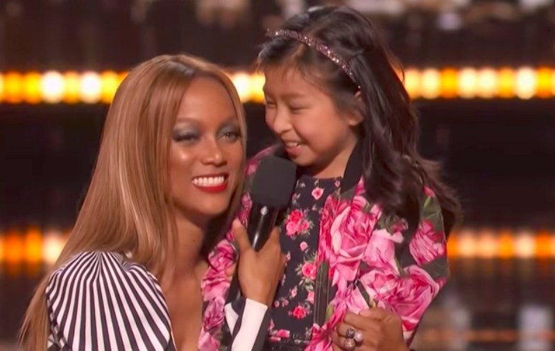 America's Got Talent host Tyra Banks onstage with Hong Kong girl Celine Tam. Photo: America's Got Talent