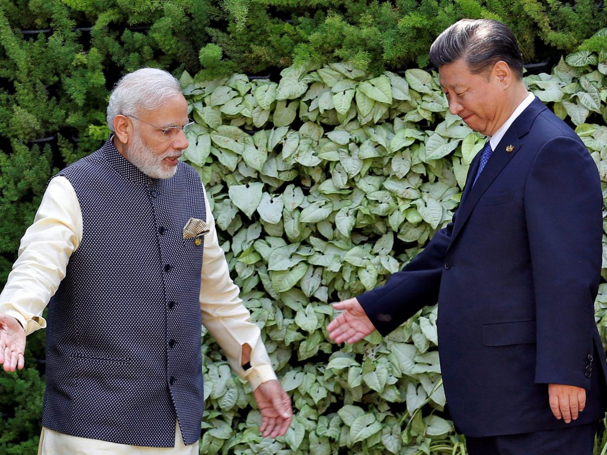 Indian Prime Minister Narendra Modi (L) and Chinese President Xi Jinping leave after a group picture during BRICS (Brazil, Russia, India, China and South Africa) Summit in Benaulim, in the western state of Goa, India, October 16, 2016. Photo: Reuters/Danish Siddiqui/File Photo