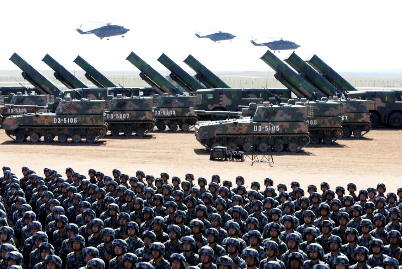 Soldiers of China's People's Liberation Army take part in a military parade to commemorate the 90th anniversary of the foundation of the PLA, at the Zhurihe military training base in Inner Mongolia Autonomous Region, China, on July 30, 2017. Photo: Reuters / Stringer