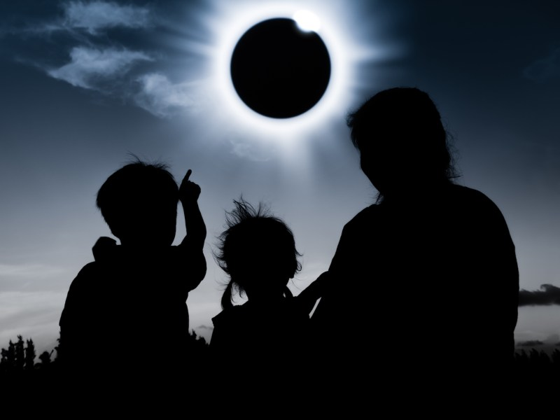 A family views a solar eclipse on August 1, 2017. Photo: iStock/Getty Images