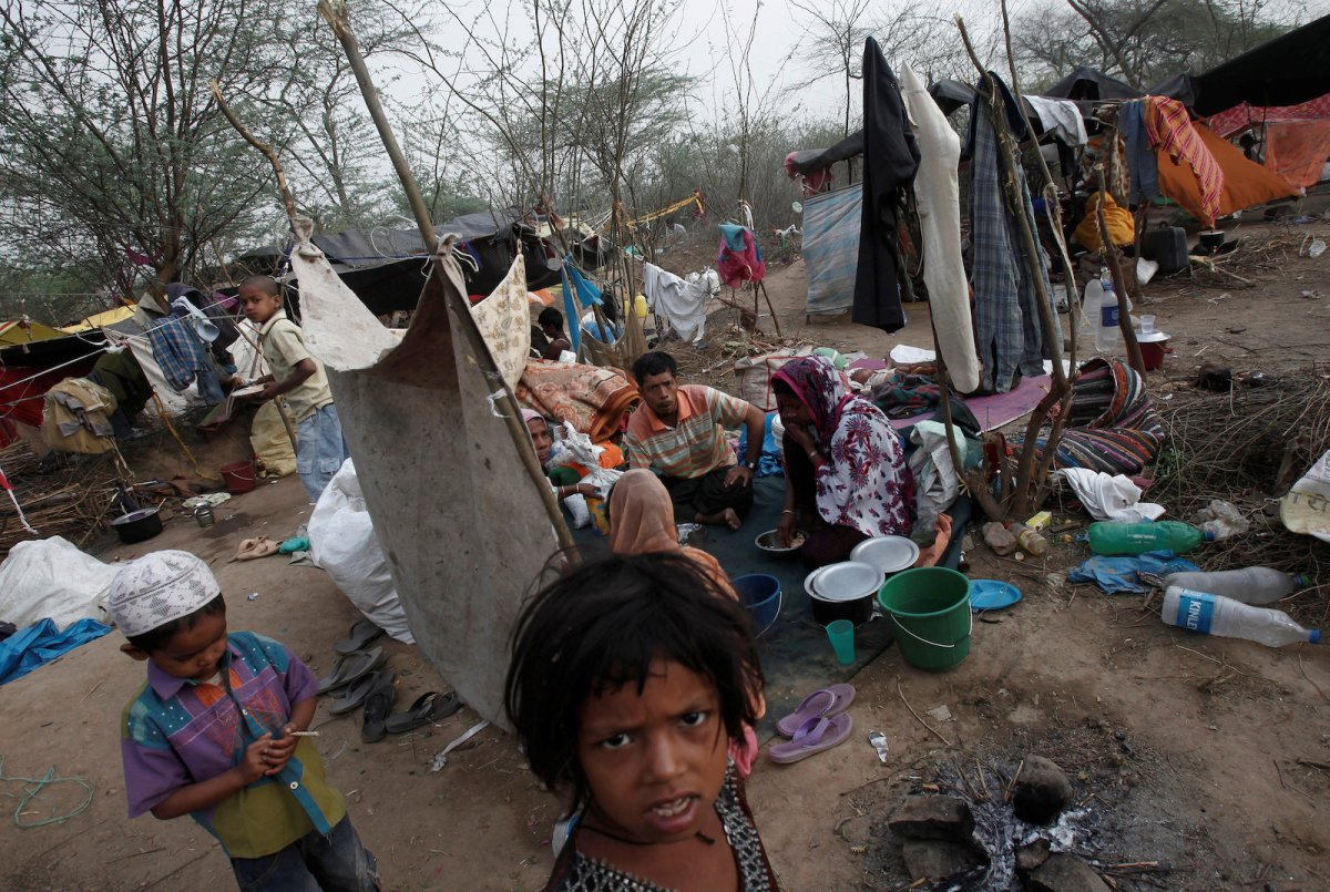 A family that says they belong to Myanmar's Rohingya community eats breakfast at a makeshift shelter in a camp in New Delhi in this file photo. Photo: Reuters/ Adnan Abidi