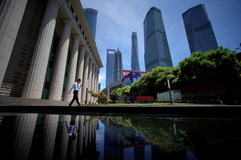 A man walks at Lujiazui financial district of Pudong in Shanghai. Photo: Reuters/Aly Song