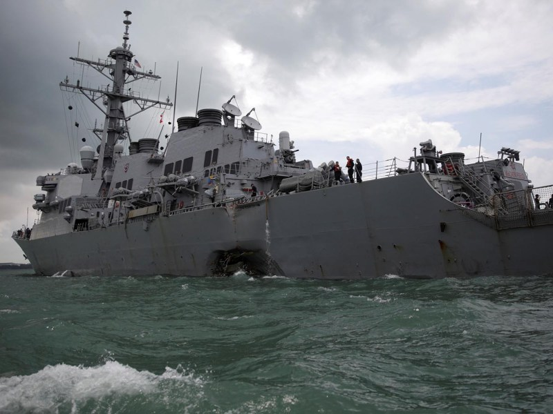 The US Navy guided-missile destroyer USS John S McCain after a collision, in Singapore waters on August 21, 2017. Photo: Reuters/Ahmad Masood