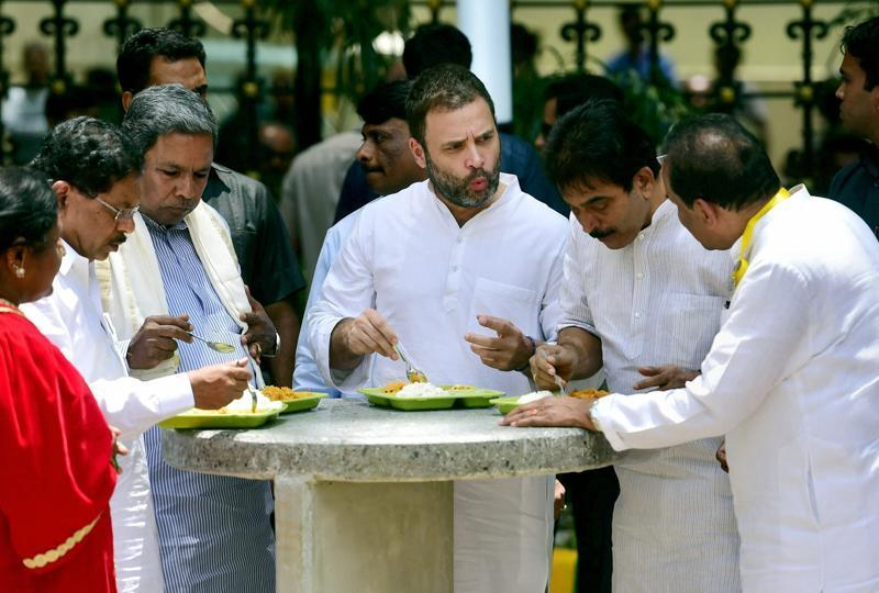 Congress Vice President Rahul Gandhi, center, with Karnataka Chief Minister Siddaramaiah and others at the new Indira Canteen in Bangalore on Wednesday. Photo: Hindustan Times