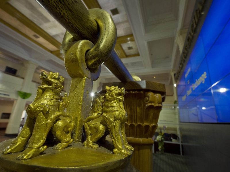 A detail on the bronze bell at the Yangon Stock Exchange. Photo: AFP / Romeo Gacad