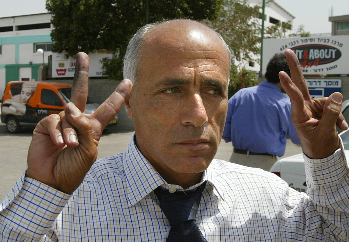 "Former Israeli nuclear technician Mordechai Vanunu flashes the V-sign   after winning his freedom on 21 April 2004. Vanunu said he was ""proud and happy"" to have blown the whistle on Israel's nuclear program as he was released at the end of an 18-year prison sentence. The one-time technician at the Dimona nuclear plant in southern Israel was abducted by secret service agents in Italy, then smuggled back to Israel and jailed back in 1986 after leaking details of the plant to Britain's Sunday Times newspaper. Photo: AFP / Yoav Lemmer"
