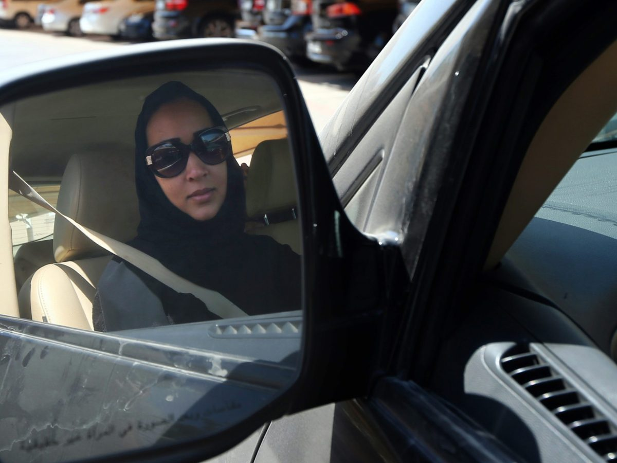 Manal Al-Sharif drives her car in Dubai on October 22, 2013. She is among the Saudi women who defied the country's laws in the fight to be allowed to take to the wheel. Photo: AFP / Marwan Naamani