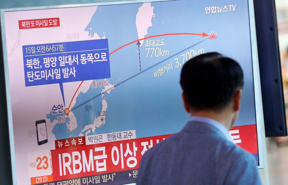 People watch a television broadcasting news of North Korea firing a missile that flew over Japan's northern Hokkaido far out into the Pacific Ocean. Photo: Reuters/Kim Hong-Ji