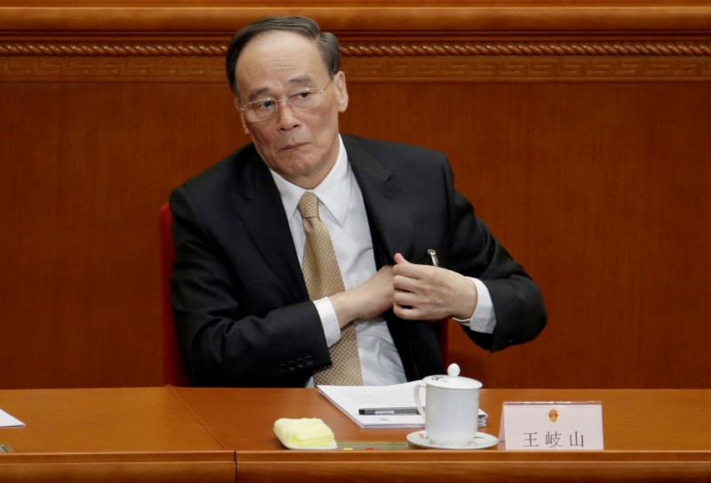 China's Politburo Standing Committee member Wang Qishan, the head of China's anti-corruption watchdog, attends the opening session of the National People's Congress in Beijing. Photo: Reuters/Jason Lee