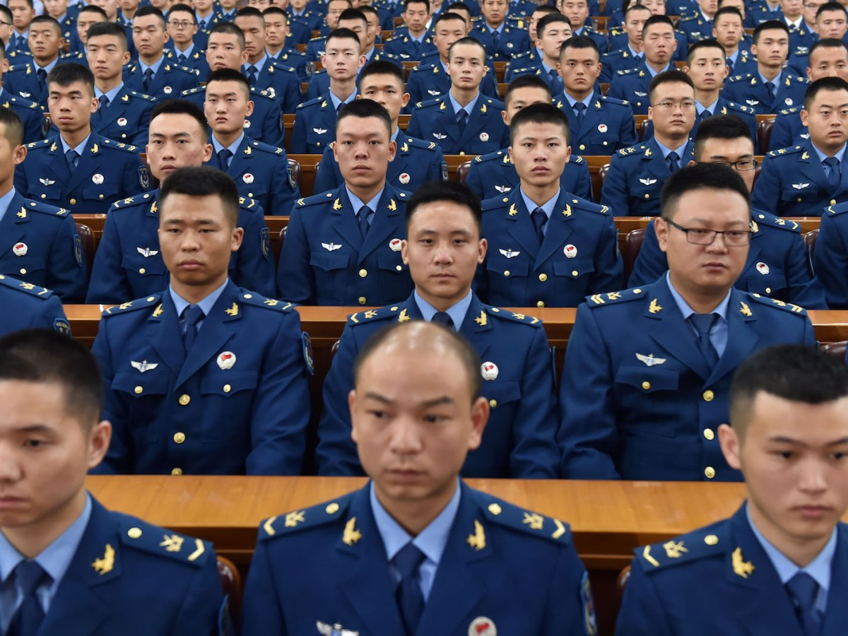 Chinese PLA soldiers attend a grand rally to mark the 90th founding anniversary of the People's Liberation Army (PLA) at the Great Hall of the People in Beijing, China, 1 August 2017. Photo: AFP