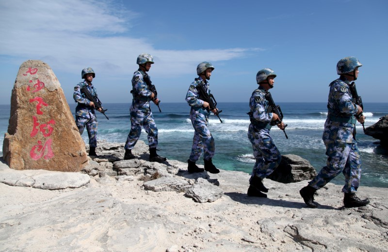 China's People's Liberation Army (PLA) Navy soldiers patrol at Woody Island, in the Paracel Archipelago in the South China Sea. Photo: Reuters