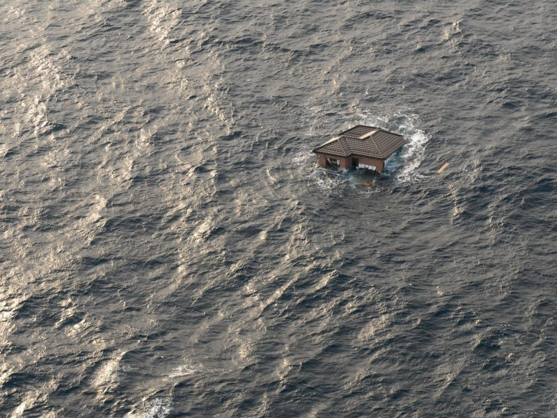 Japanese house drifting in the Pacific Ocean after the March 11, 2011 earthquake and tsunami devastated the coastline. US Navy photo/Dylan McCord