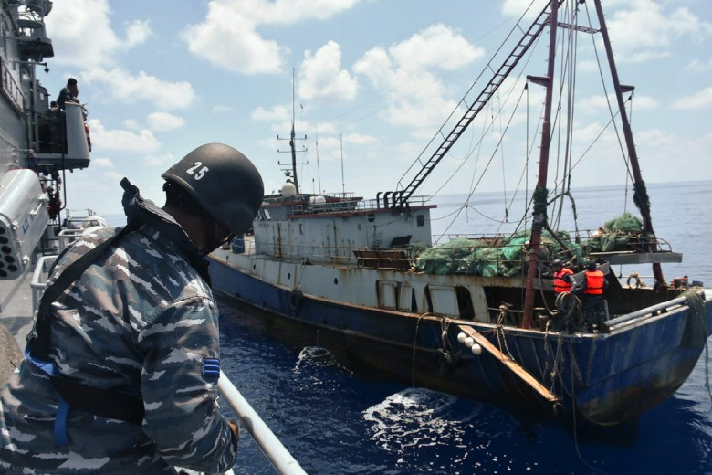 """This handout photo released by the Indonesian Navy and available on June 21, 2016 shows Indonesian War Ship KRI Imam Bonjol-363 (L) arresting a Chinese fishing boat (R) in Natuna water. Indonesia's navy said on June 21 that poaching by Chinese trawlers in its waters was a """"ruse"""" to stake Beijing's claim to fishing grounds, after the latest clash in the South China Sea. RESTRICTED TO EDITORIAL USE - MANDATORY CREDIT """"AFP PHOTO / INDONESIAN NAVY"""" - NO MARKETING NO ADVERTISING CAMPAIGNS - DISTRIBUTED AS A SERVICE TO CLIENTS / AFP PHOTO / INDONESIA NAVY / HANDOUT / RESTRICTED TO EDITORIAL USE - MANDATORY CREDIT """"AFP PHOTO / INDONESIAN NAVY"""" - NO MARKETING - NO ADVERTISING CAMPAIGNS - DISTRIBUTED AS A SERVICE TO CLIENTS"""
