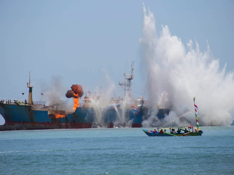 The demolition and sinking of a pirate fishing ship by the Indonesian Navy at the Pangandaran Sea, West Java. Photo: NurPhoto via AFP/ Donal Husni
