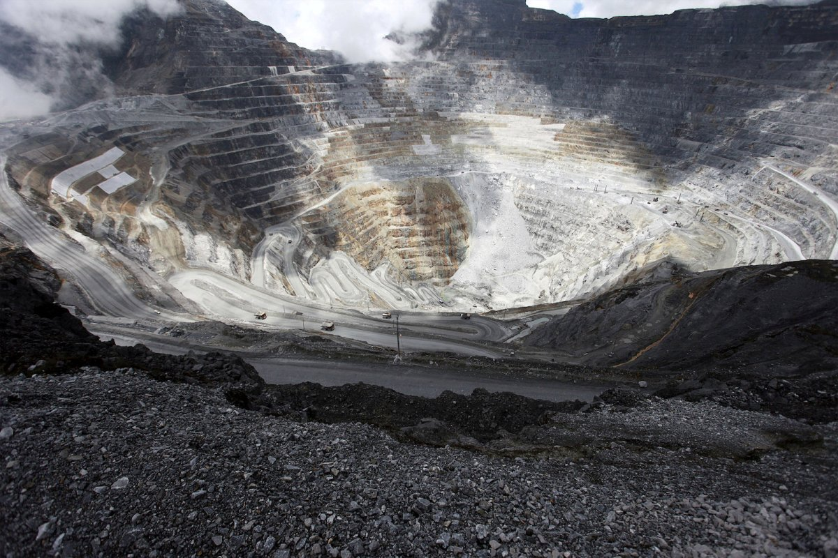 Trucks operate in the open-pit mine of PT Freeport's Grasberg copper and gold mine complex near Timika, in the eastern region of Papua, Indonesia on September 19, 2015 in this photo taken by Antara Foto. Reuters/Muhammad Adimaja/Antara Foto