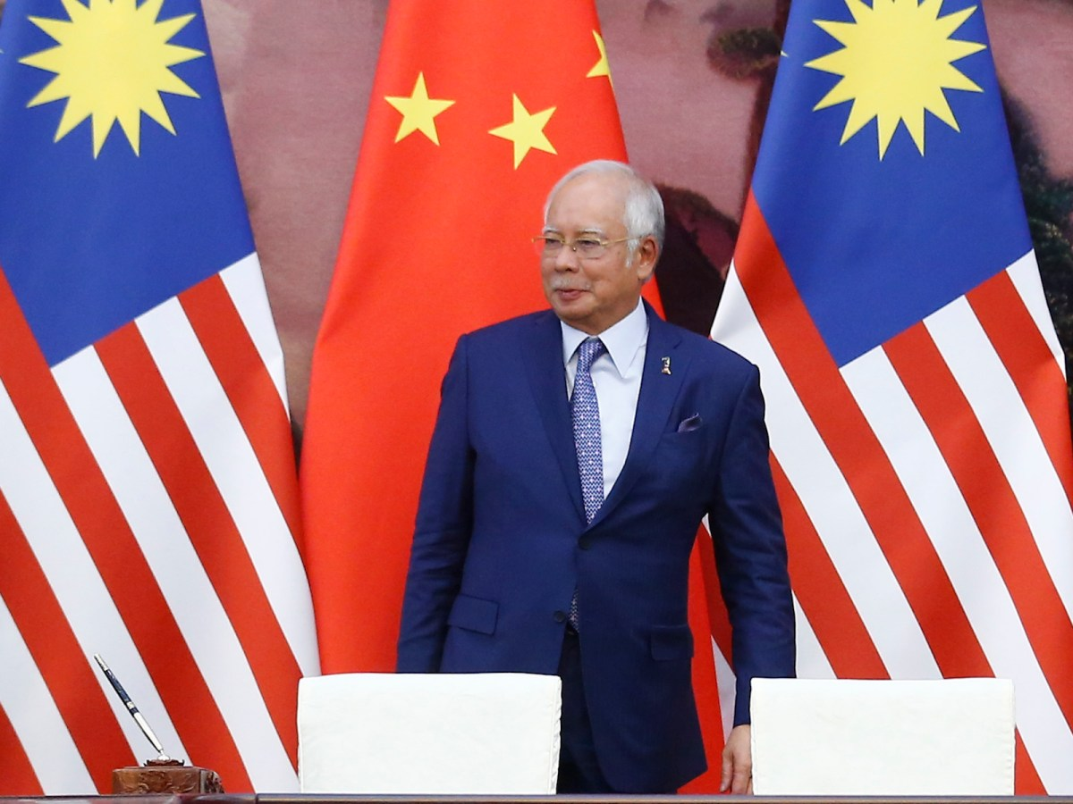 Malaysian Prime Minister Najib Razak leaves a signing ceremony at the Great Hall of the People in Beijing on May 13, 2017. Photo: AFP/pool/Thomas Peter