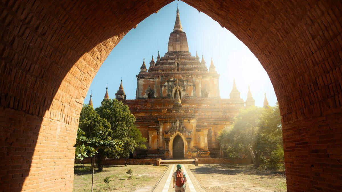 Traveler walking along the road to the Htilominlo temple in Bagan, Myanmar
